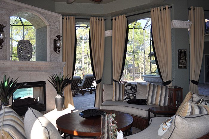 To complete their outdoor cabana area, we installed several grommet style side panels with a black banding and black fabric tie backs to soften the sitting area. We used a Sunbrella fabric which is low maintenance, water resistant, and will last for years. The rods which are metal are also a special collection used for outdoor applications.