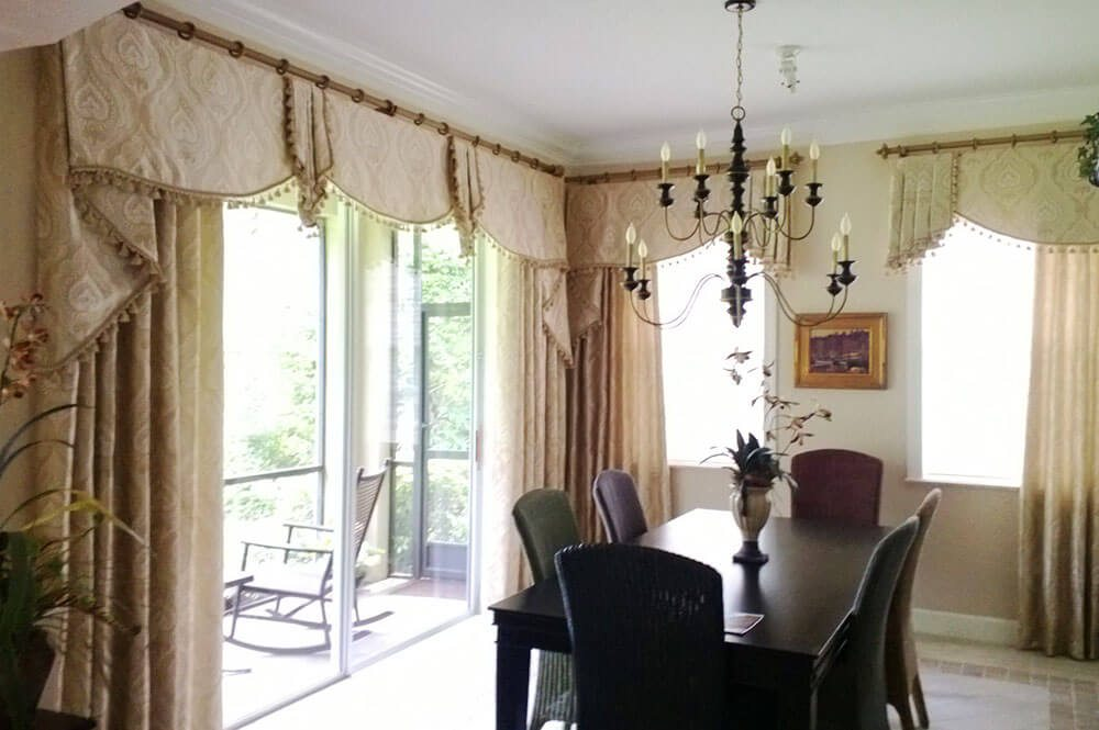 Working with talented designer Joseph Trees these complicated but elegant valances and side panels hang from decorative rods with rings. They are all embellished with tassel trim.
