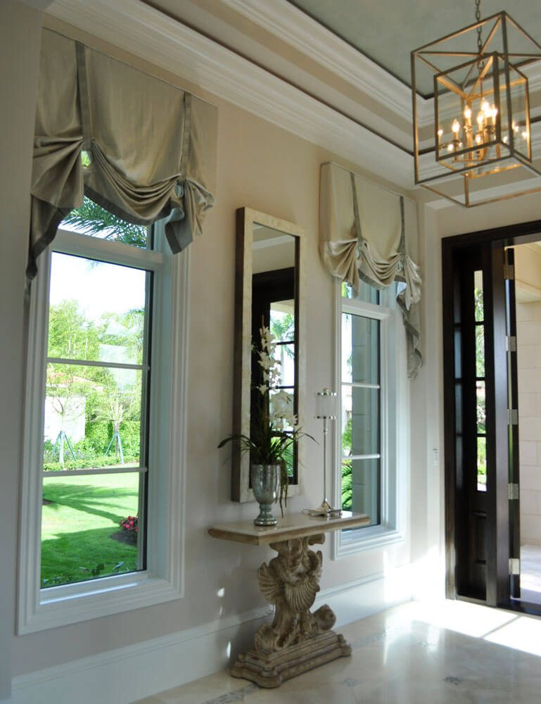Metallic grommet style valances in this Tiburon Estate home, greet you as you enter the home.
